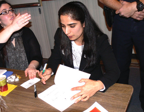 Malalai Joya sign her book for supporters
