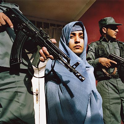 Malalai Joya with armed guards